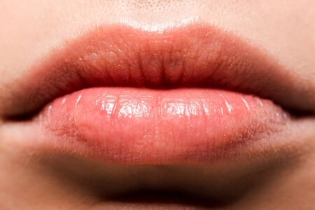 cropped view of shiny lips with lip gloss