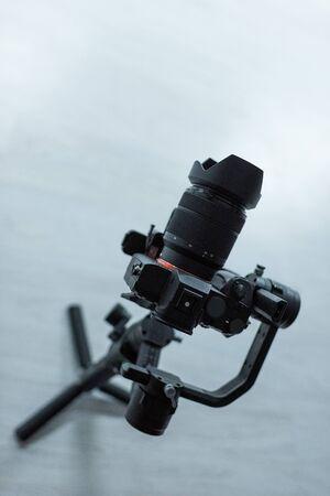 black digital camera on tripod in studio