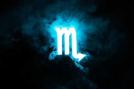 blue illuminated Scorpio zodiac sign with smoke on background