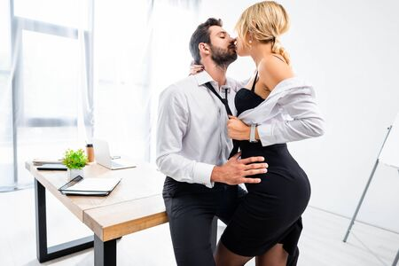 Sexy secretary tempting businessman at office table
