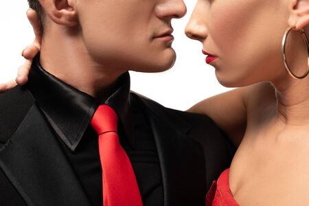 cropped view of sensual dancers performing tango face to face isolated on white Фото со стока