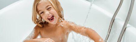 panoramic shot of happy naked kid taking bath Archivio Fotografico