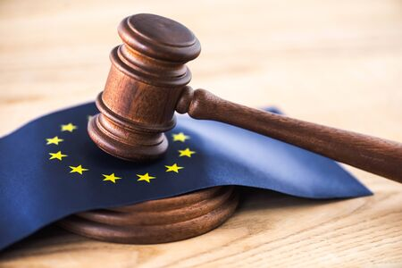 gavel of judge with european union flag on wooden table
