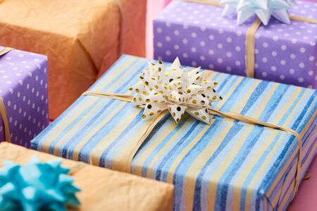 selective focus of stripped present near colorful gifts