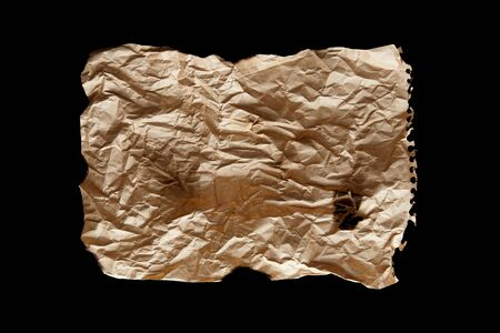 top view of empty crumpled and burnt vintage paper isolated on black
