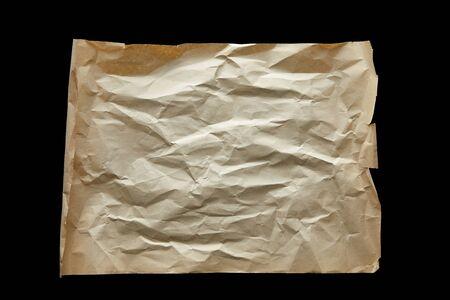 top view of empty crumpled vintage paper isolated on black 版權商用圖片