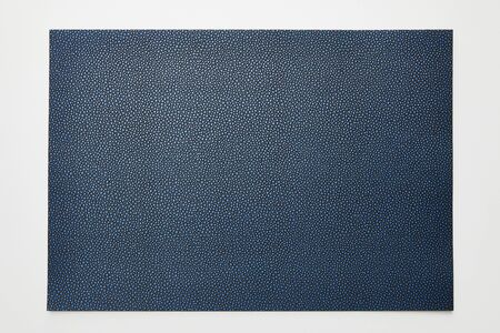 top view of empty dotted blue paper on white background