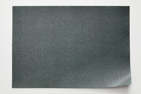 top view of empty dotted grey paper on white background