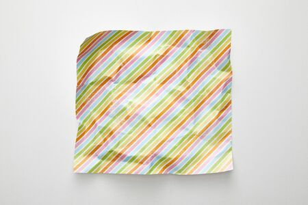 top view of empty crumpled with colorful lines on white background 스톡 콘텐츠