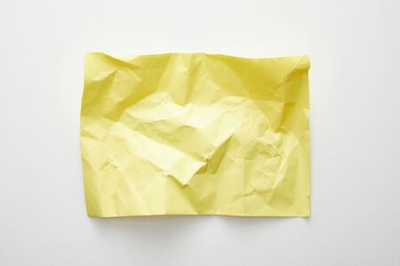 top view of empty crumpled yellow paper on white background 스톡 콘텐츠