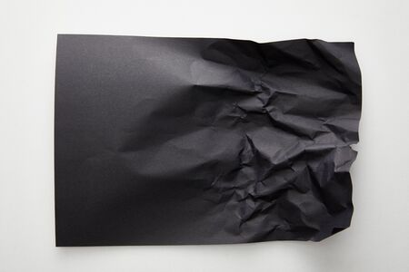 top view of empty crumpled black paper on white background