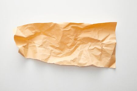 top view of empty orange crumpled paper on white background 스톡 콘텐츠