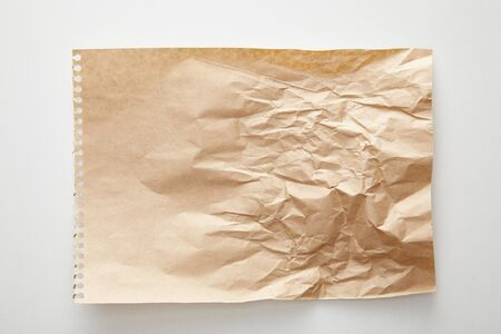 top view of empty crumpled craft paper on white background 스톡 콘텐츠