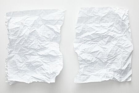 top view of empty crumpled paper sheets on white background