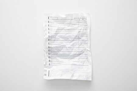 top view of empty crumpled paper on white