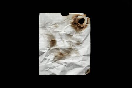 top view of empty white crumpled and burnt vintage paper isolated on black