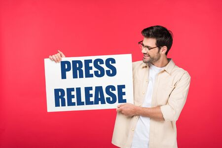 handsome man holding white placard with press release illustration isolated on red