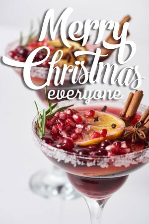 selective focus of christmas cocktail with orange, pomegranate, cinnamon with merry christmas everyone illustration Stok Fotoğraf