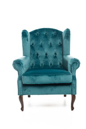 Modern turquoise armchair isolated on white