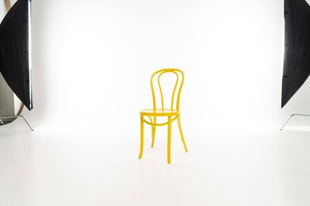 Yellow chair with studio light on white background Stock Photo