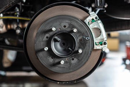 close up view of assembled disk brakes with brake caliper
