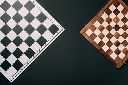 Top view of checkerboards isolated on black Banque d'images