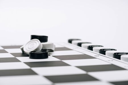 Selective focus of black and white checkers on checkerboard isolated on white
