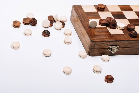 Wooden checker and chessboard isolated on white Standard-Bild