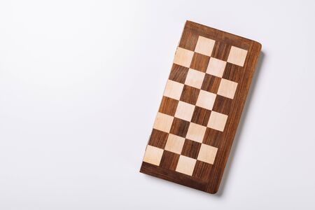Top view of wooden checkerboard on white background with copy space 版權商用圖片 - 137420236