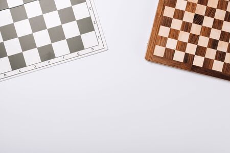 Top view of checkerboards isolated on white with copy space