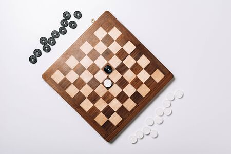 Top view of checkers on wooden chessboard on white background 版權商用圖片