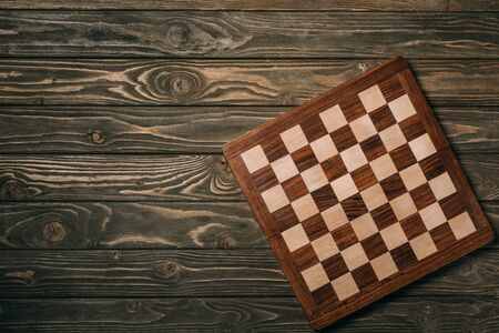 Top view of chessboard on wooden surface 版權商用圖片