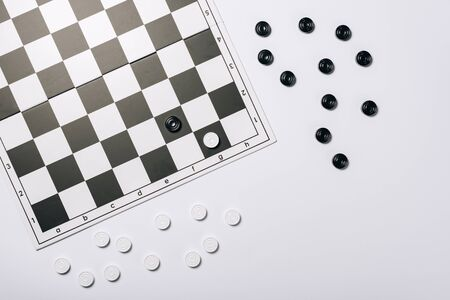 Top view of chessboard with black and white checkers isolated on white