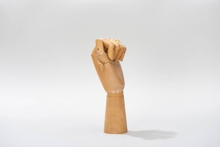 Wooden hand of puppet on grey background with copy space Stock Photo