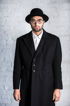 handsome jewish man in glasses looking at camera