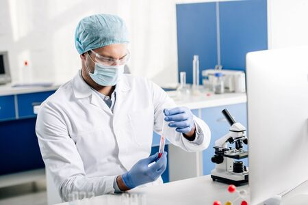genetic consultant in white coat doing dna test in lab