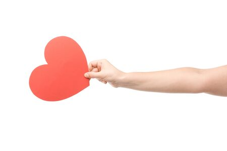 cropped view of woman holding heart-shaped card isolated on white