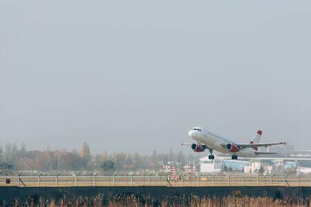 Flight departure of airplane on airport runway 写真素材