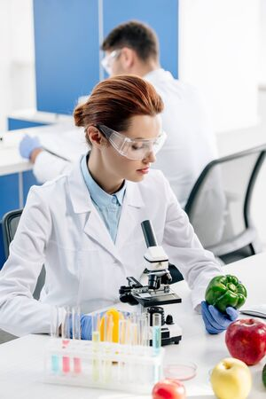 molecular nutritionist holding and looking at bell pepper in lab Stok Fotoğraf
