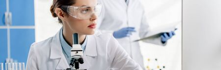 panoramic shot of molecular nutritionist in goggles looking away Stok Fotoğraf