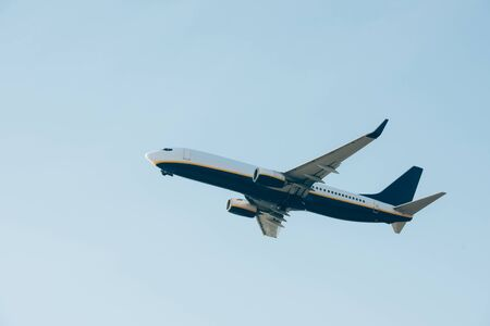 Commercial jet liner taking off in blue sky Stock Photo