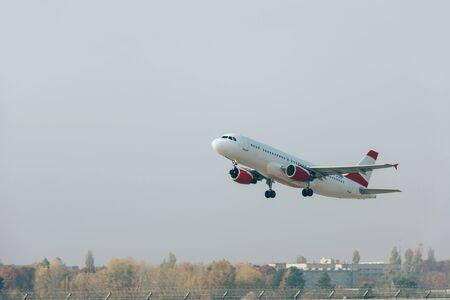 Flight departure of jet plane above airport runway 写真素材