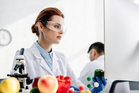 selective focus of molecular nutritionist using computer in lab