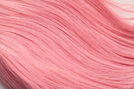 Close up view of pink hair on white background