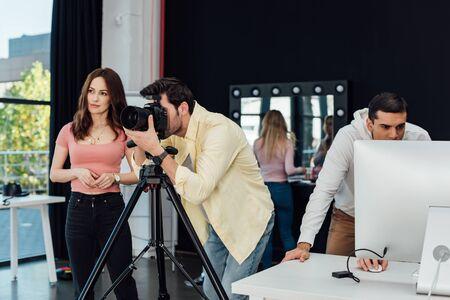 photographer taking photo near art director and assistants Banco de Imagens - 138255168