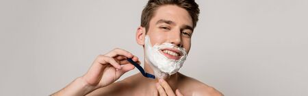 smiling sexy man with muscular torso shaving isolated on grey, panoramic shot Stock fotó - 138356024