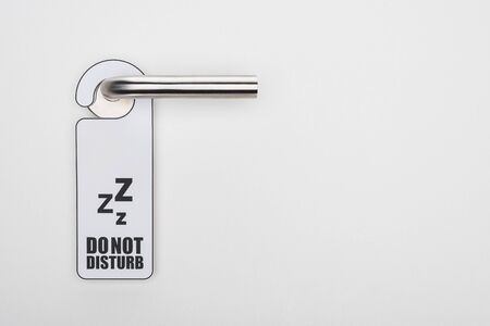 do no disturb sign on handle on white background 版權商用圖片