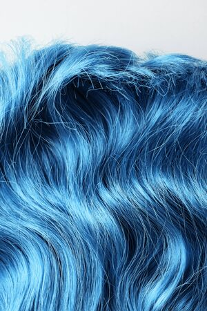Top view of wavy blue hair isolated on white
