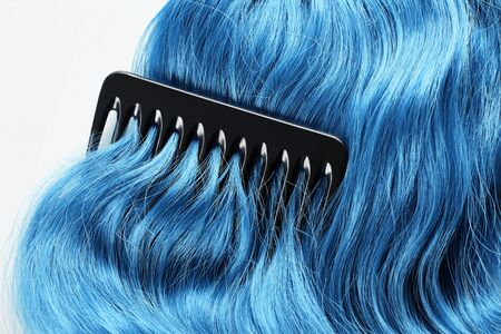 Top view of comb on colored blue hair isolated on white 版權商用圖片