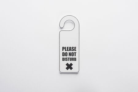 top view of please do no disturb sign on white background